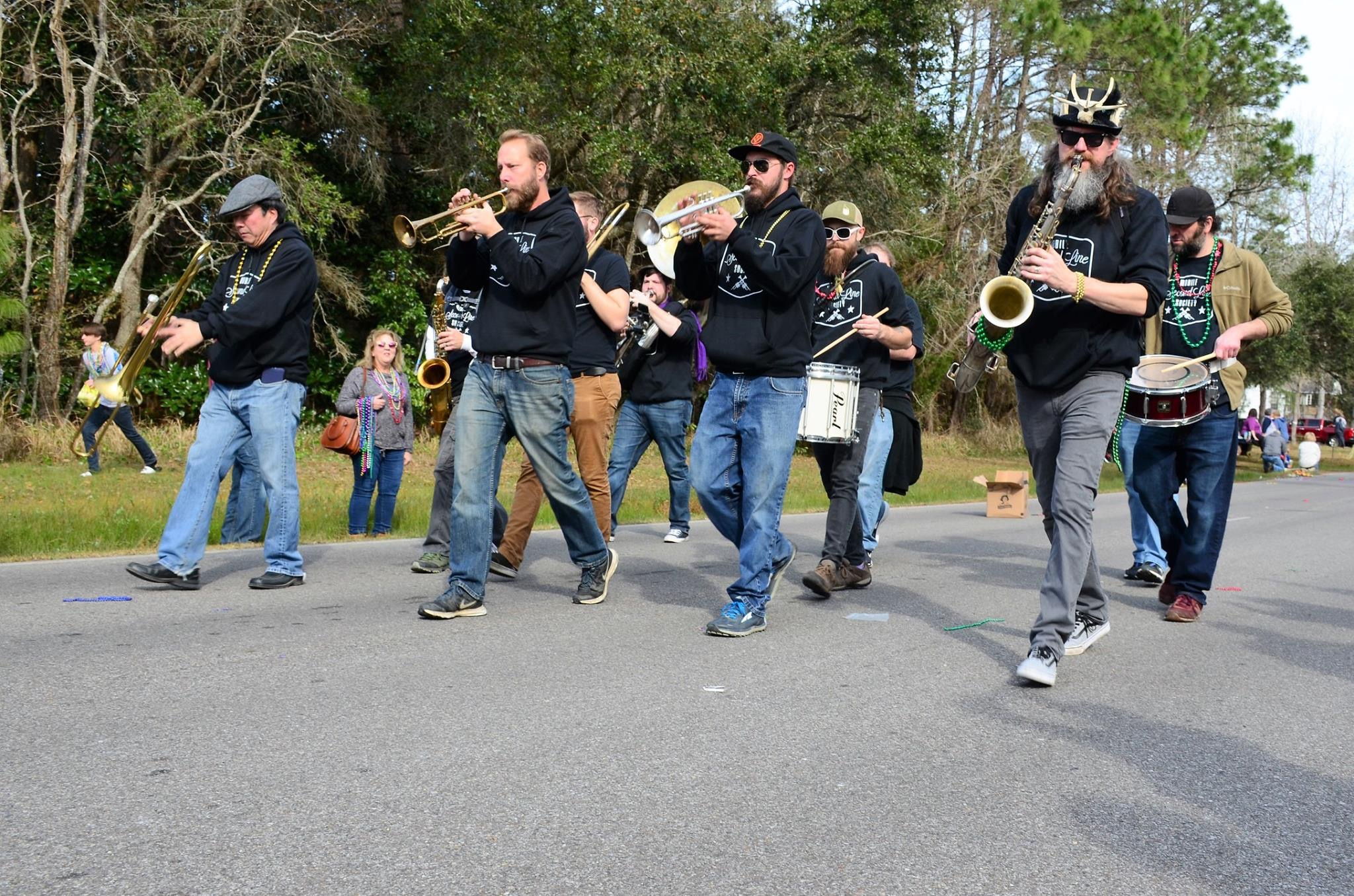 band marches in the mardi gras parade playing music